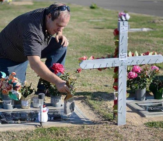 Darin Roam spends nearly all his time at his wife's grave
