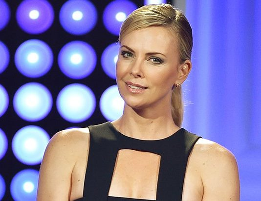Charlize Theron says she may leave America because of racism