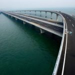 China opens world's longest sea-crossing bridge