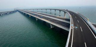 China opens world's longest sea-crossing bridge