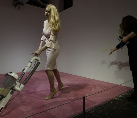 Art exhibit shows Ivanka Trump lookalike vacuuming up crumbs (Photo)