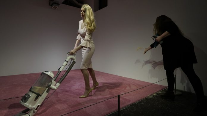 Art exhibit shows Ivanka Trump lookalike vacuuming up crumbs (Photo)