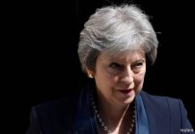 Theresa May promises Brexit vote by Feb. 27 to avert revolt