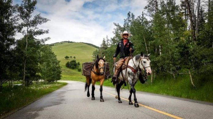 Brazilian Cowboy finishes Alaska-Calgary trek with Stampede honour