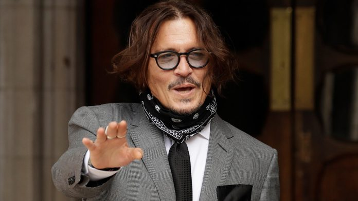 Johnny Depp tells court Amber Heard threw 'haymaker' punch at him, Report