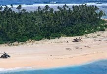 'SOS' in the sand saves Pacific island mariners (Photo)