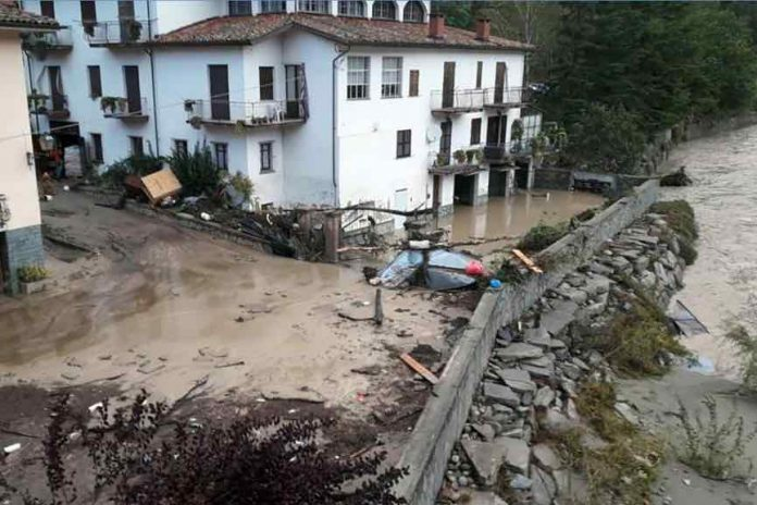 Two dead, 24 missing after floods in France and Italy