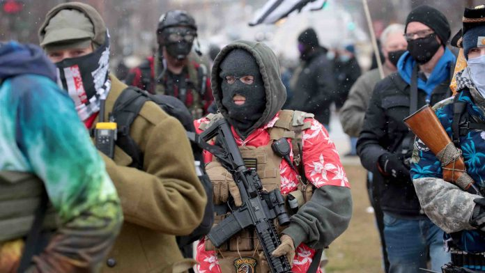 Armed protesters begin to gather at Michigan state capitol, Report