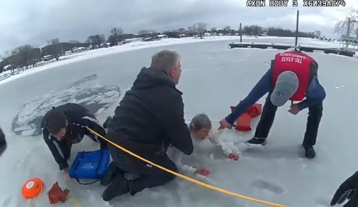 Dramatic rescue of woman and dog who fell through ice (Video)