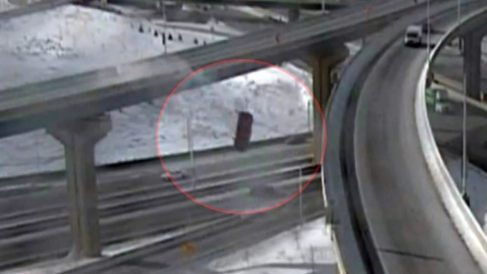 Man drives truck off 21-meter-high bridge and survives (Watch)