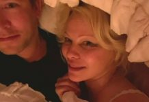 Pamela Anderson Shocks TV Hosts During Chaotic Interview in Bed With Hubby (Video)
