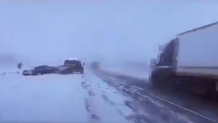 Watch: Semi-truck loses control almost hitting state trooper on I-70