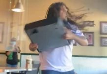 Angry customer throws cash register through window