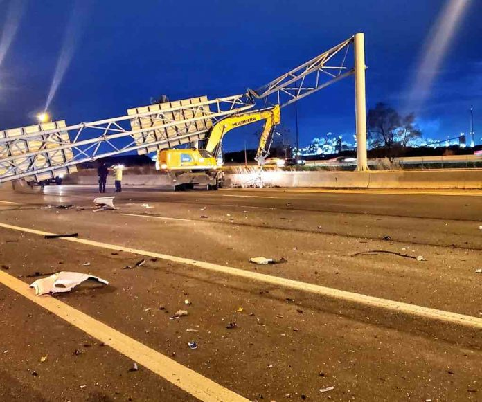 Toronto man dead after large sign on QEW crushes vehicle: OPP