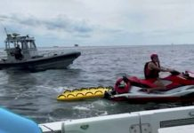Sunbathers stranded after blow-up boat drifts 3kms from shore (Video)